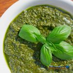 fresh pesto in a bowl with fresh basil leaves