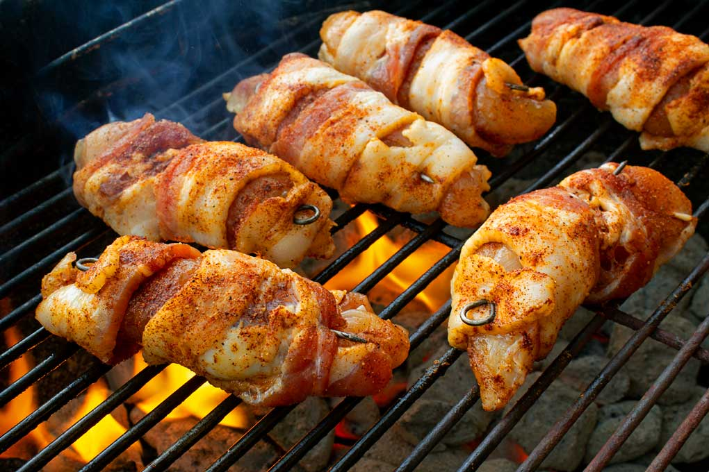 bacon-wrapped chicken tenders grilling