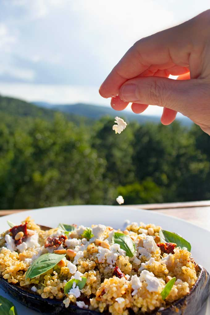 Fluff with a fork and toss in the prepared pesto and sun-dried tomatoes and feta cheese.