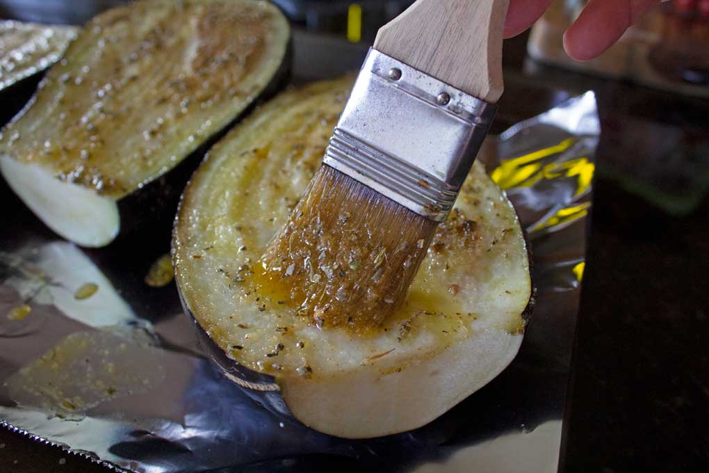 brushing eggplant with seasoned oil