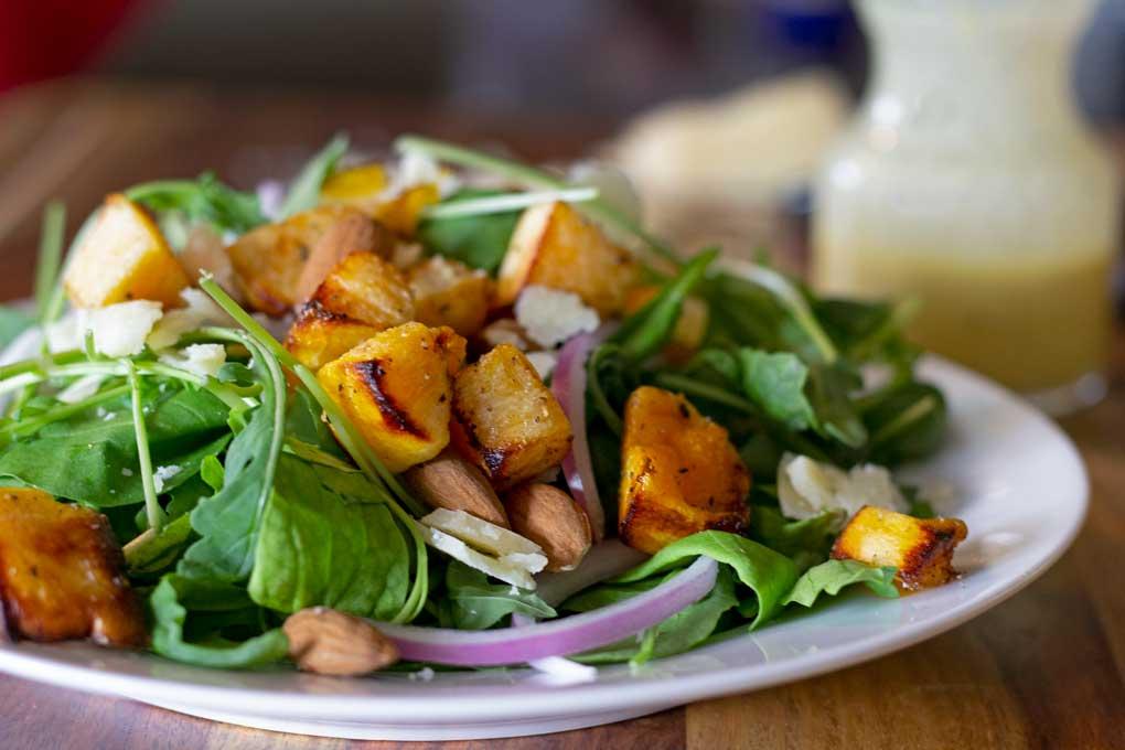butternut squash arugula salad on plate