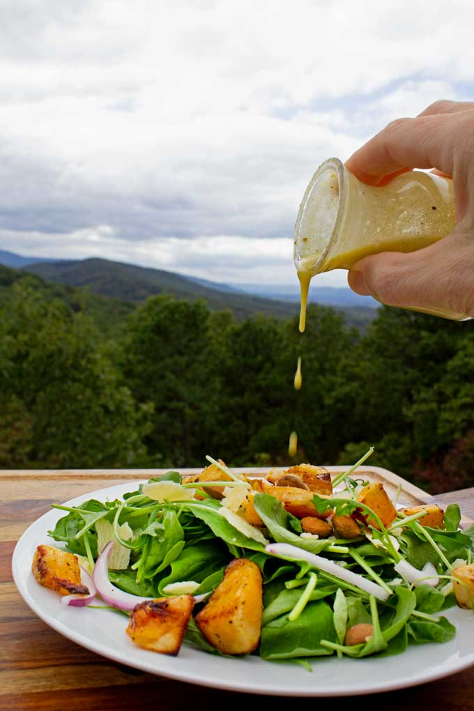 With a broad range of flavors and textures this butternut squash arugula salad is a great fall salad to serve this season for lunch or dinner!