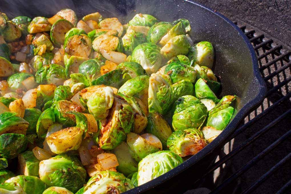 grilled brussels sprouts in pan on grill