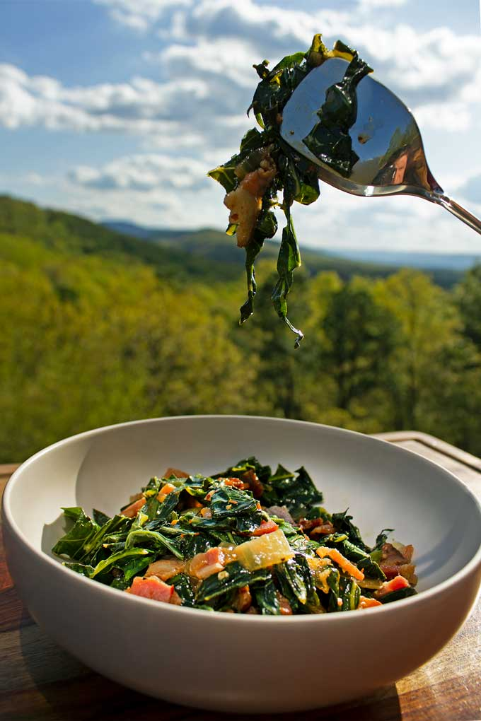 Enjoy collards any time with this quick collard greens recipe. Thinly cut ribbons of leafy greens sautéed with bits bacon, onions, and garlic.