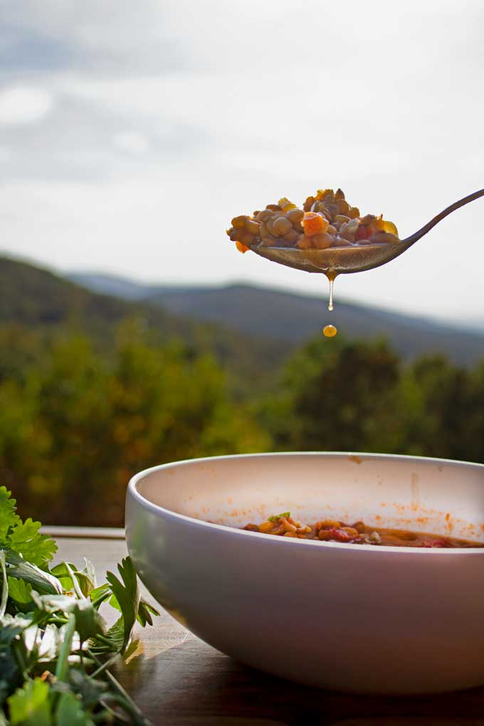 spoonful of soup with mountain view