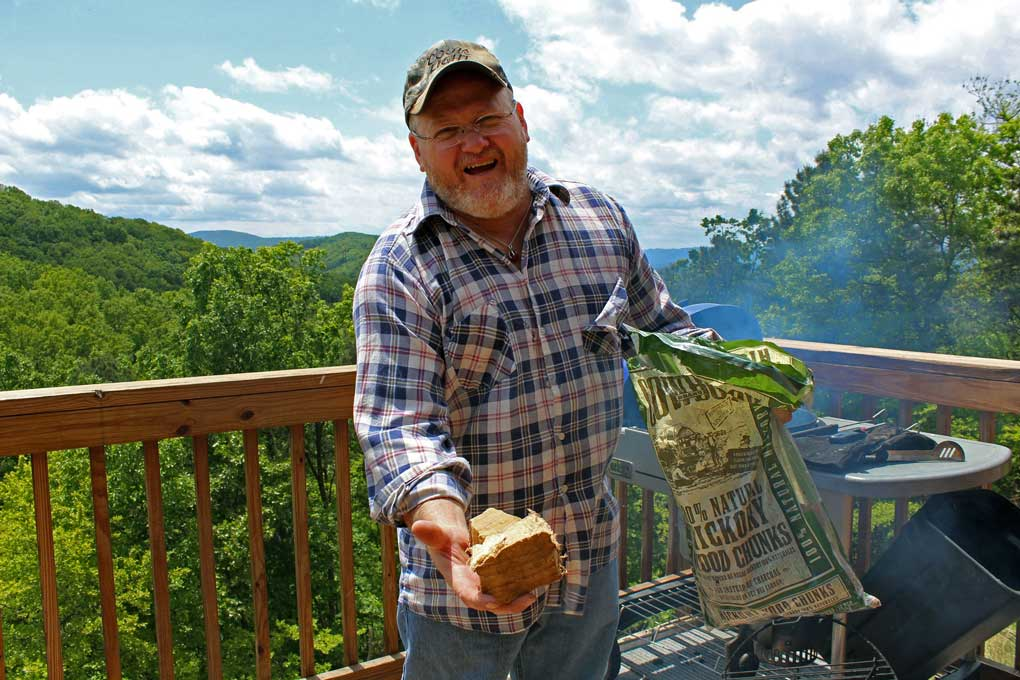 David holding hickory wood chunk