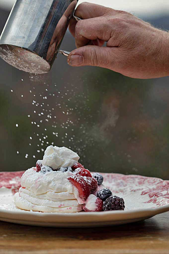 dusting pavlova with powdered sugar