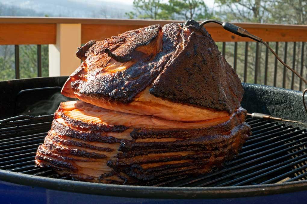 double-smoked ham smoking on grill