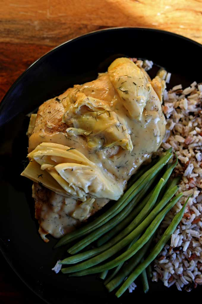 Delicious light and healthy, chicken and artichokes with lemon dill sauce a weeknight meal, under 300 calories and ready in 20 minutes!