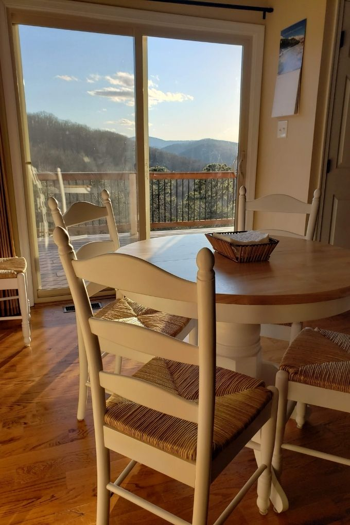table and chairs with mountain view
