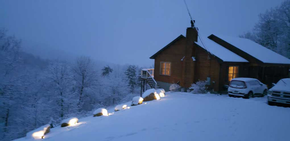 our home in evening snow