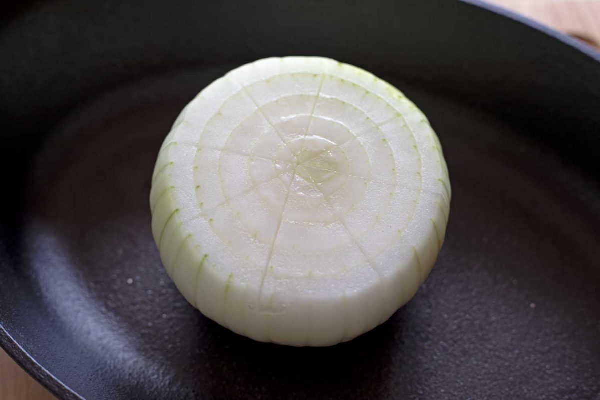 onion with crosshatch pattern cut into top