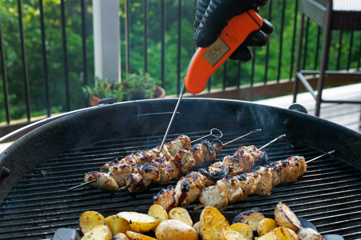 checking chicken kabobs with Thermapen instant-read thermometer