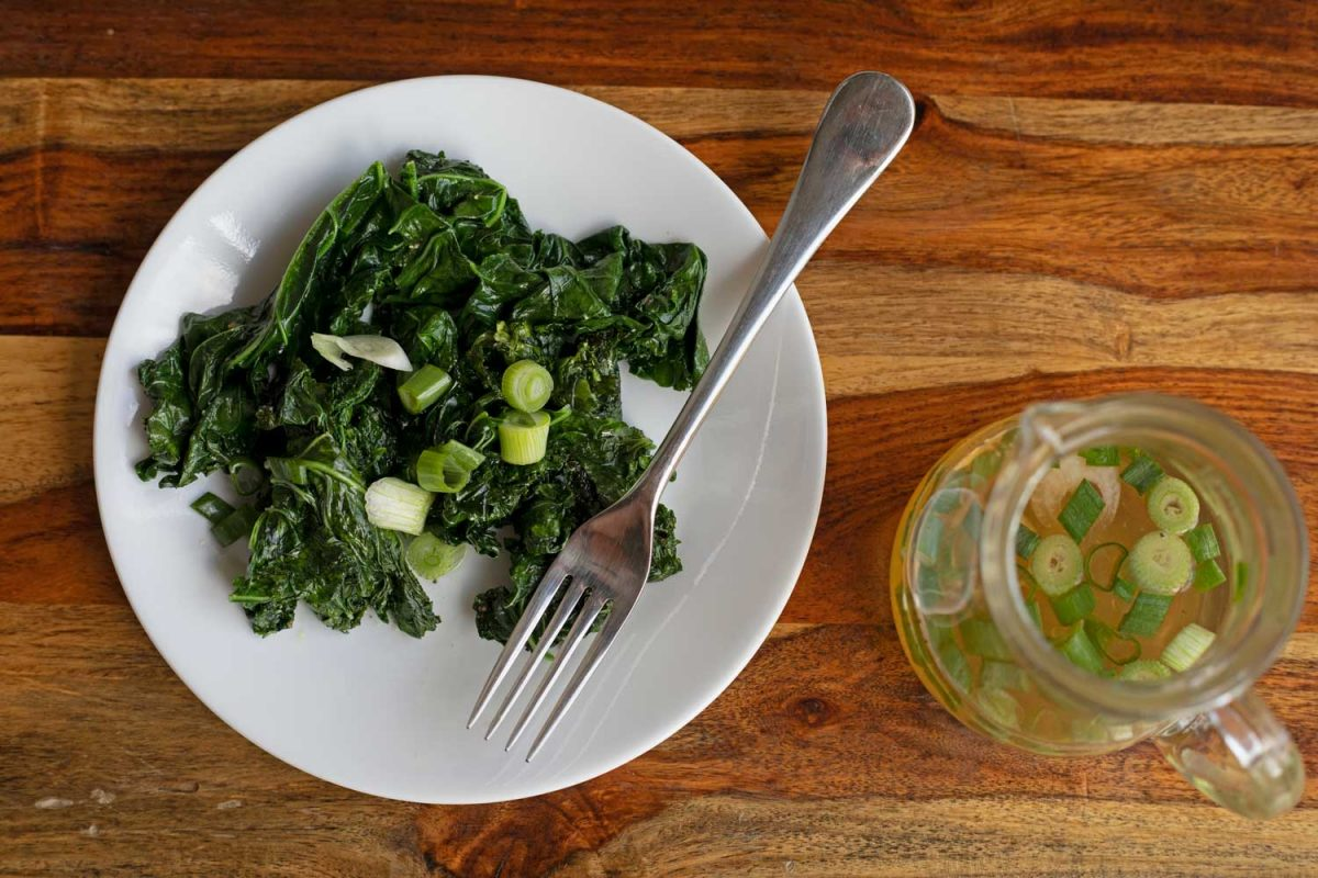 plate of sauteed kale and spring onion vinegar
