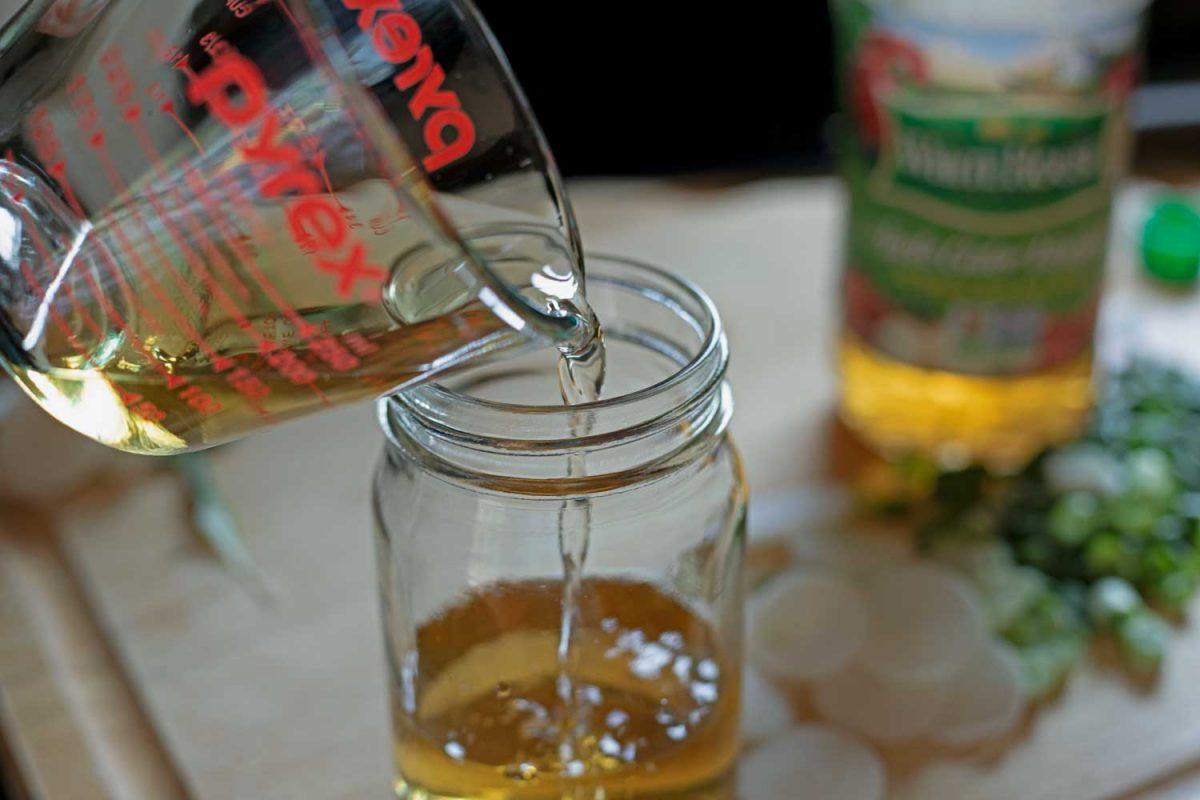 pouring vinegar into a jar