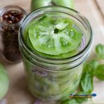 pickled green tomatoes in jar