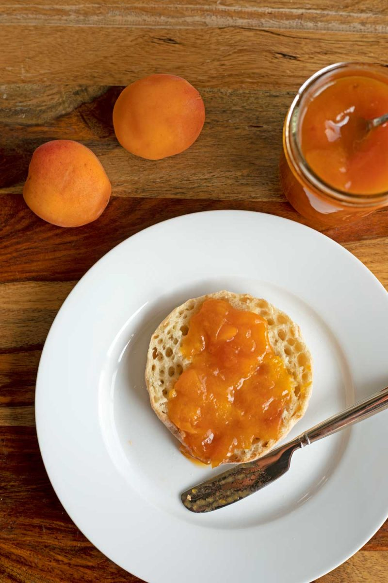 apricot jam spread on English muffin