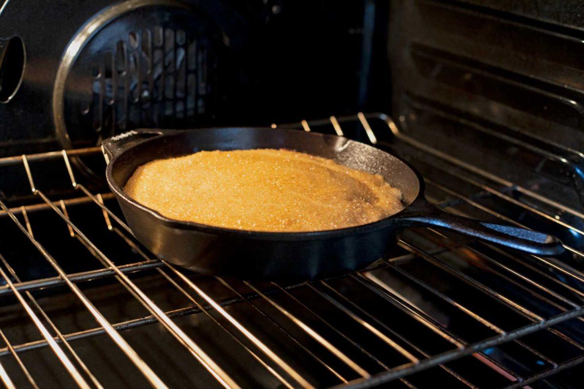 skillet cake baking inside oven