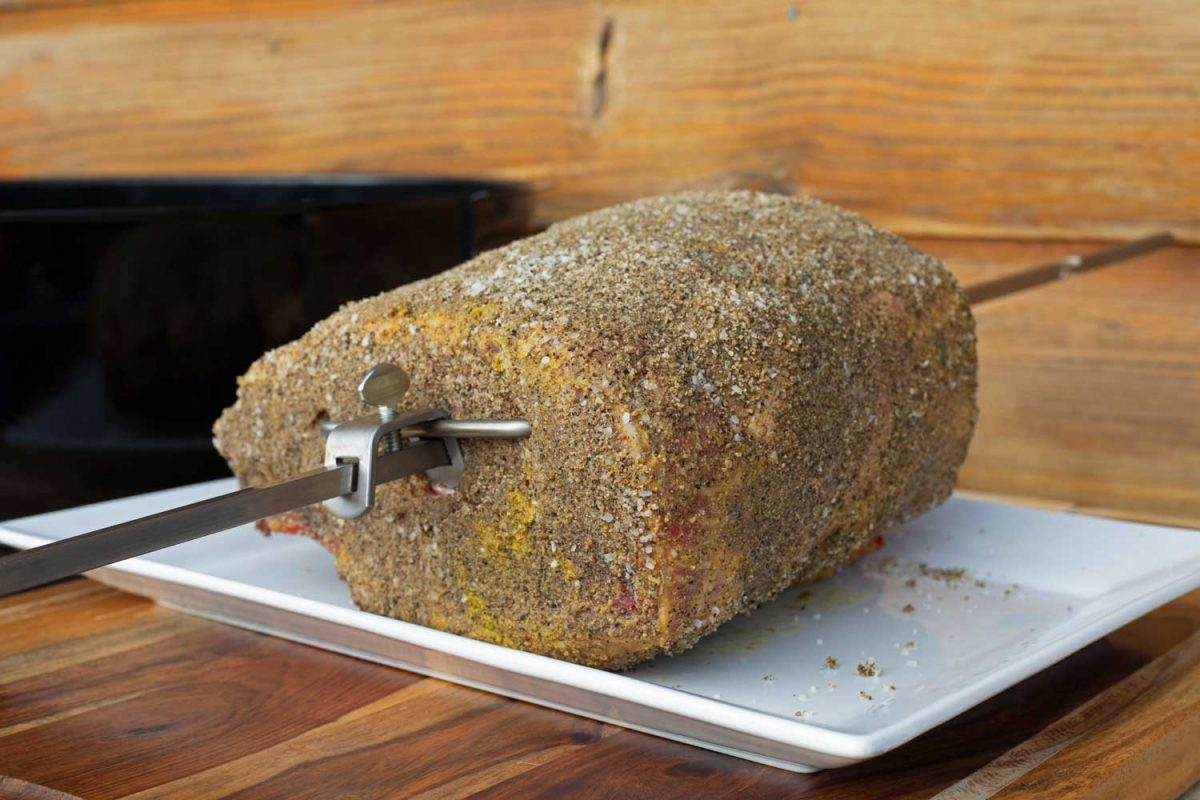 prime rib on spit coated with dry rub