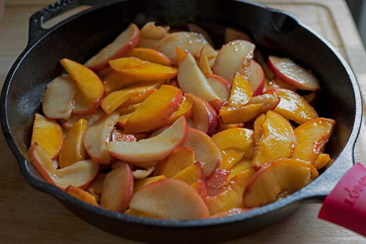 peaches inside cast-iron skillet