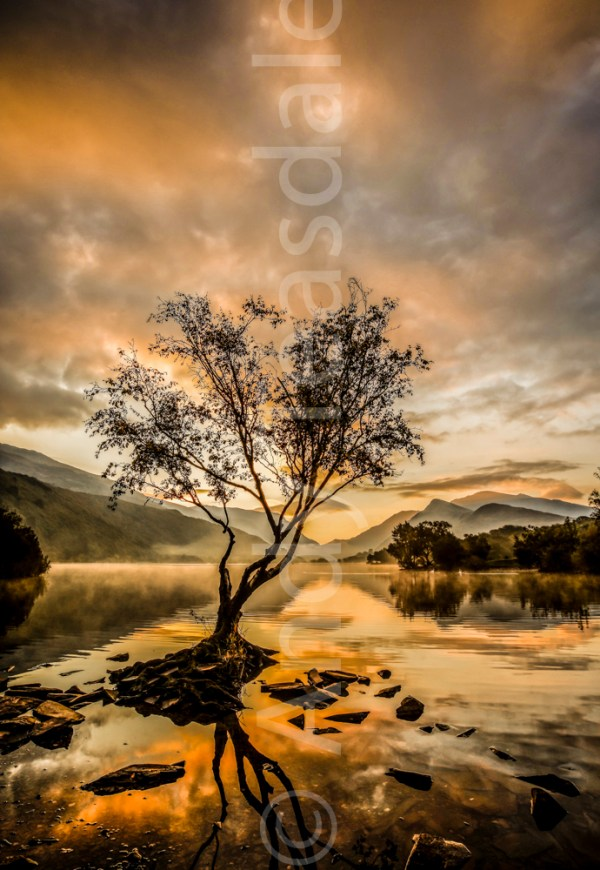 A vibrant sunrise over Llyn Padarn