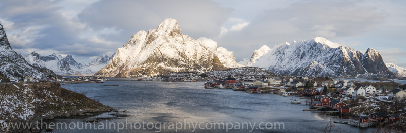 A panorama across the fjord at Reine, with majestic snow covered peaks all around