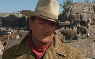 John Wayne as Wil Andersen in The Cowboys