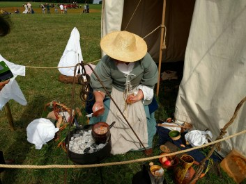 Cooking snacks for soldiers at a living history event