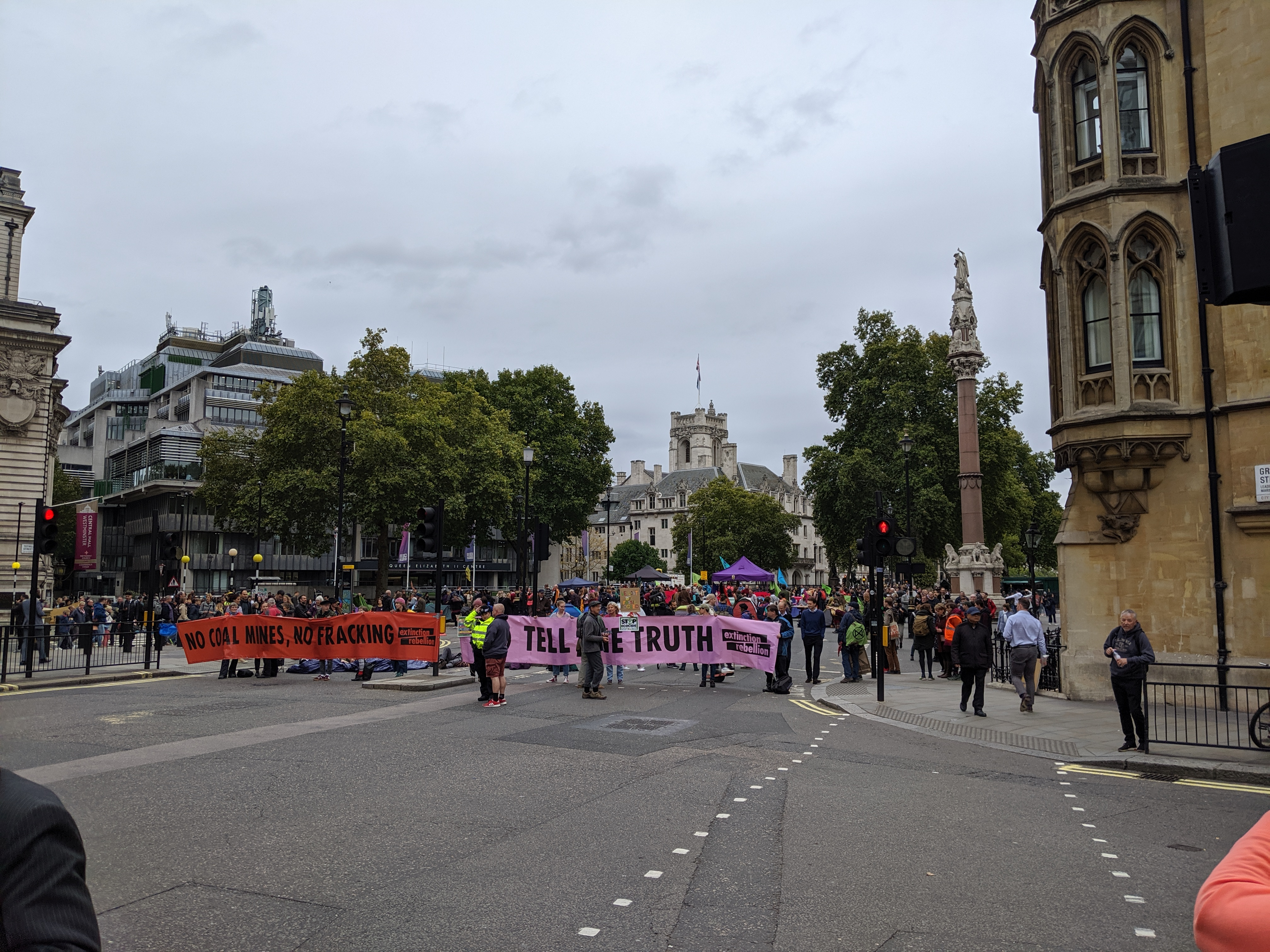Extinction Rebellion blocking the road into Parliament Square at the top of Victoria Street around noon on Monday 7th October 2019. (Photo: James Kemp)