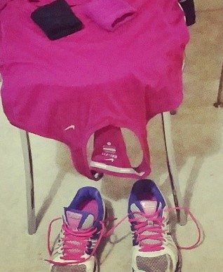 Asics Gel Nimbus 15 TRainers on floor, running clothes on chair