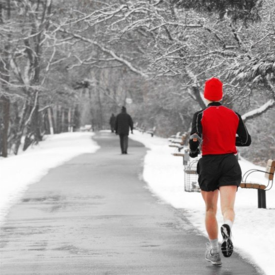 Tips For Running in the Winter - man running in snow on path