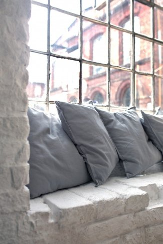 Create a cozy nook - pillows by the window - encouraging toddler reading
