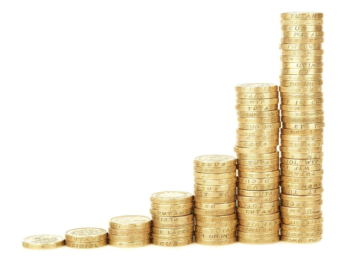 7 towers of pound coins displayed on a white background going upwards like a graph from left to right