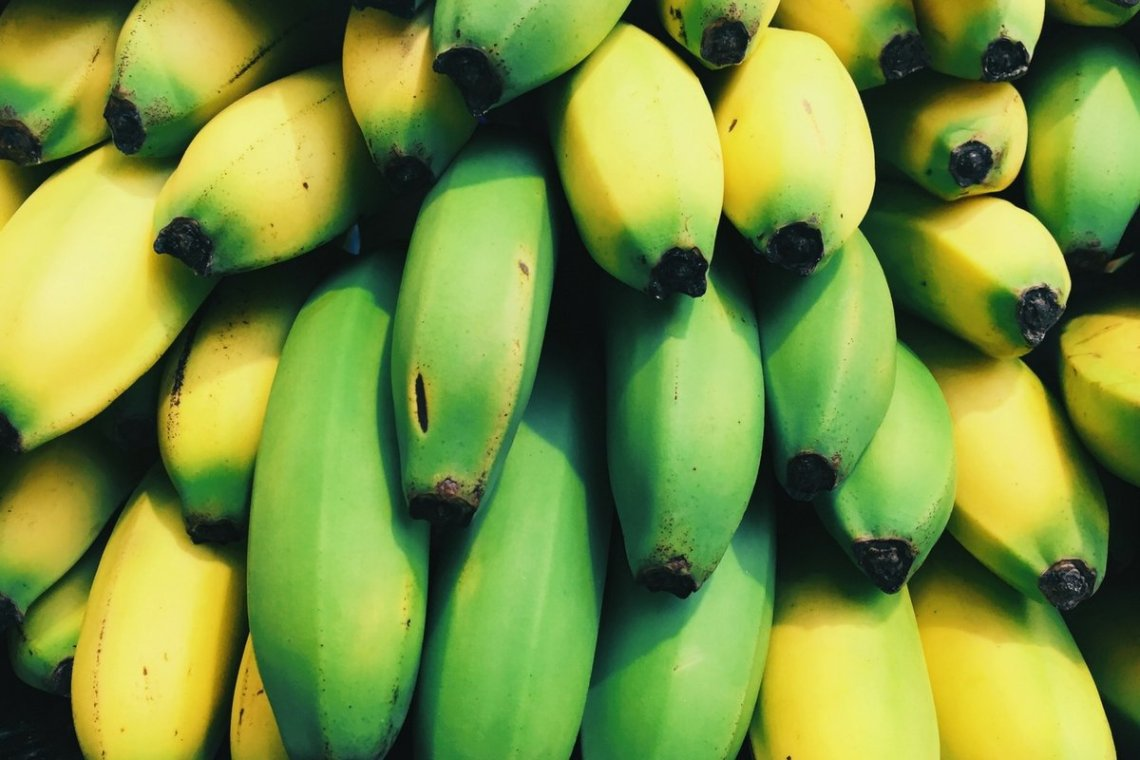 close up picture of green and yellow banana
