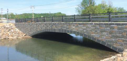 The arch on the completed Elk Drive Bridge is a Bebo system by Contech Engineered Solutions. The headwalls were also precast; the stone pattern was stained in the field to give it the look of natural stone. (Photo provided)