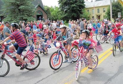 Children love to come out for the decorated bike portion of the parade.