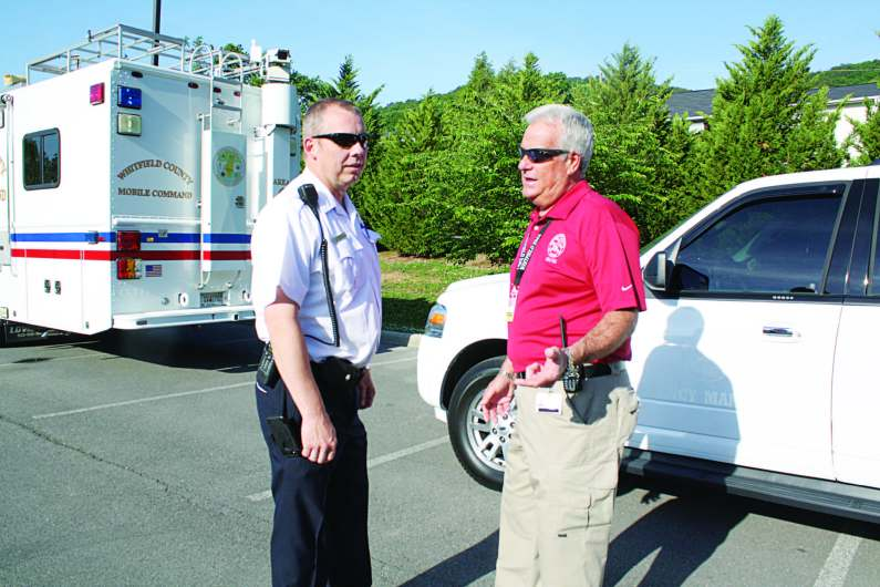 Whitfield County Emergency Management Director Claude Craig, right, and his battalion chief discuss plans for a full-scale exercise held in 2015. (Photo provided)
