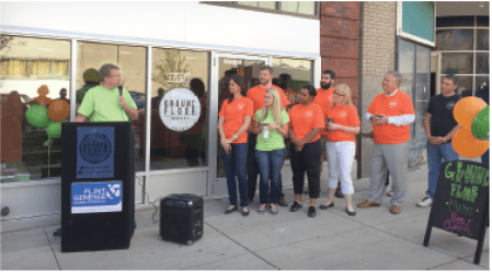 Ground Floor Market was the fi rst new business to locate in the Dryden building, downtown, aft er it was purchased last year by a business investment company that anticipates developing it becoming a Flint icon. (Photo provided by Flint & Genesee County Chamber of Commerce)