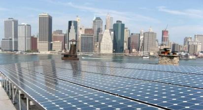Shown is a rooftop system that was installed by Solar Energy Systems and funded by the U.S. Department of Energy through its Solar America Communities program. New York, one of the 25 Solar America Cities, is focusing on integrating photovoltaic systems throughout the city. (Provided by the Department of Energy)