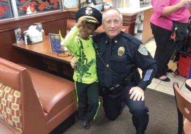 Developing strong ties with the community has been a major goal for Chief Paul Hartinger. Here, he poses with a potential future recruit during a fundraiser at a local restaurant. The fundraiser was for a scholarship program the Blue Ash Police Department is involved with to help teens, particularly those who live in the Hazelwood neighborhood, attend UC Blue Ash. (Photo provided)