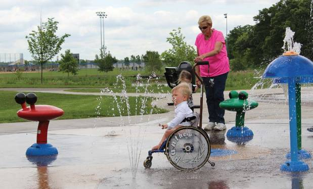 A young park goer visits the splash pad water feature, which is adjacent to Madison's Place. The city funded the construction of the splash pad as part of the Bielenberg Sports Center expansion project. (Provided by city of Woodbury)