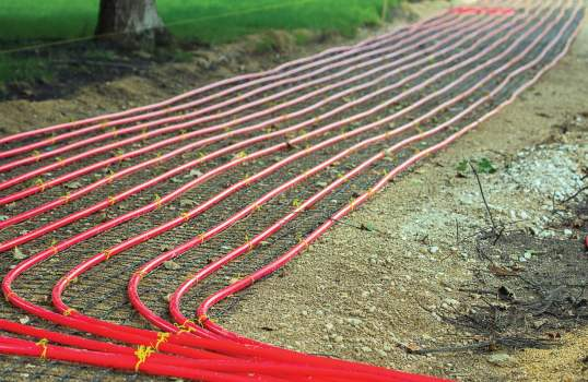 Rows of PEX, or Polyethylene crossed, tubing is placed under the sidewalks of Holland, Mich., to carry the heated water from the power plant to the downtown streets. (Photo provided)