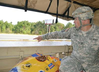 Army Sgt. 1st Class Timothy White surveys flood damage in Princeville, N.C., while on patrol with the North Carolina National Guard's 514th Military Police Company on duty as part of the NCNG's Reaction Force deployed to eastern North Carolina, Oct. 14, 2016. Princeville is still struggling to recover from Hurricane Matthew; however, many citizens have committed to rebuilding. (U.S. Army National Guard photo by Sgt. 1st Class Robert Jordan, North Carolina National Guard Public Affairs/Released)