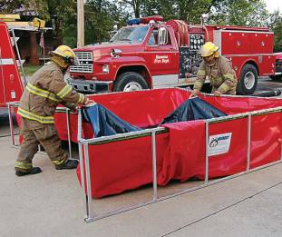 Firefighters take advantage of Husky Portable Containment's Easy Lift Handles, which make removing leftover water a breeze. (Photo provided)