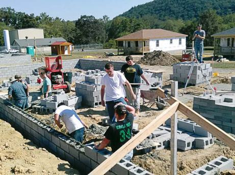 Students from Tazewell High School in Virginia work on a foundation. (Photo provided)
