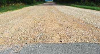 Some citizens may consider gravel a temporary measure, which makes education important to ensure that it is understood that only when revenue matches the costs of the investment will a road be repaved. (Shutterstock.com)