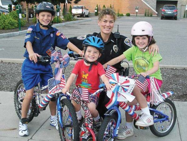 Lt. Lara Fening interacts with some young members of the Oxford, Ohio, community. Fening, along with Hahn, agree that women are a valuable asset to their departments and are often viewed as more approachable by community members. (Photo provided)