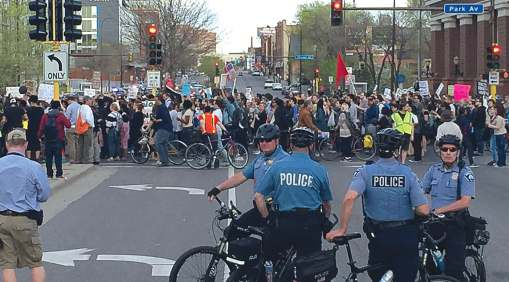 A crowd of protestors moves along and through the intersection of a Minneapolis street as members of the Minneapolis Police Department's Bicycle Rapid Response Team are nearby in case of any signs of potential trouble. (Photo provided)
