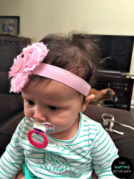 baby with a bird hair bow