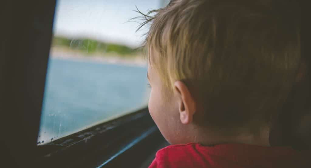 road trip - child viewing the lake